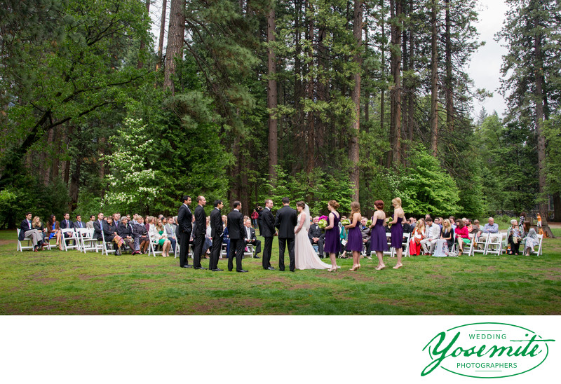 Wedding on the lawn in soft rain at majestic Yosemite Hotel