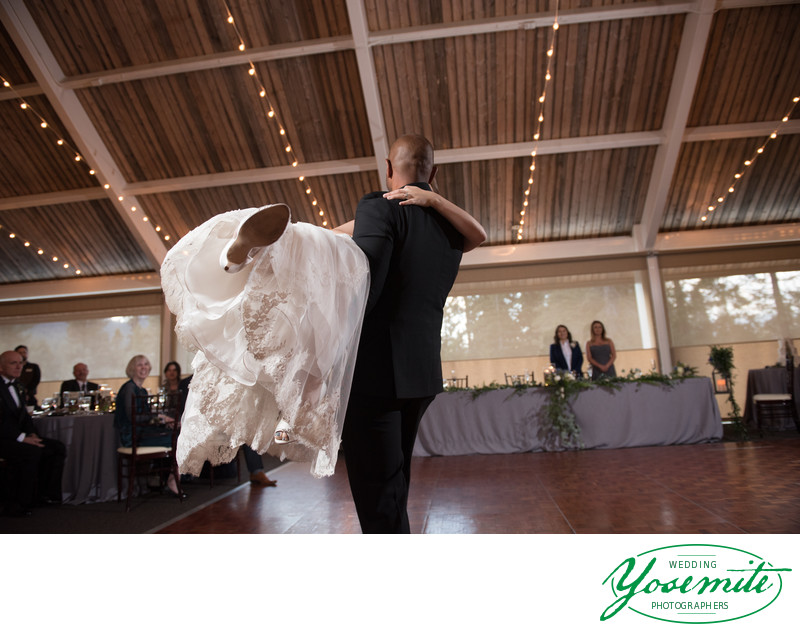 Groom Sweeps Bride Off Her Feet On Dance Floor at Tenaya Lodge