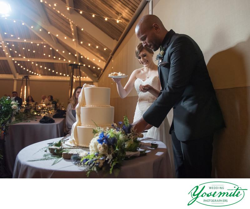 Bride And Groom Cut The Cake At Tenaya Lodge Wedding