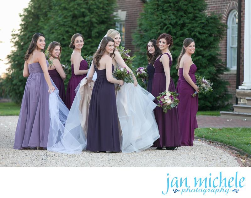 Bridesmaids wear violet, plum, purple dresses - Belmont Country Club