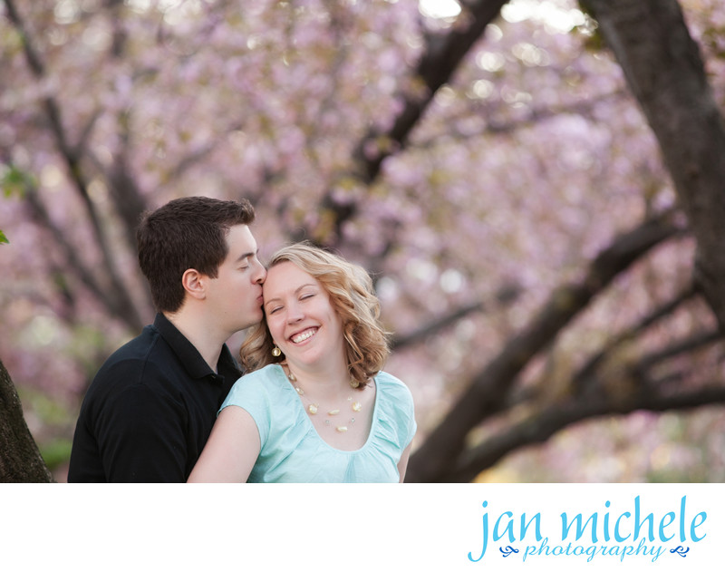 Engagement photo under the cherry blossoms