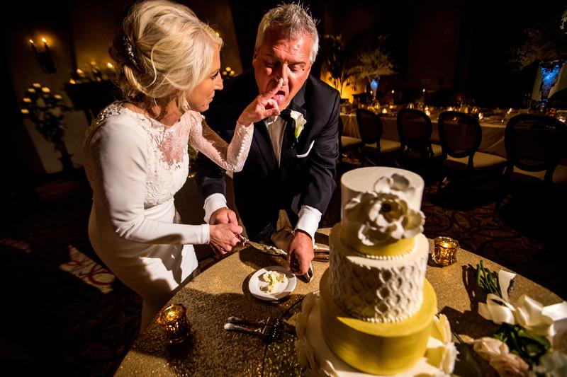 fun cake cutting photo at wedding in Scottsdale