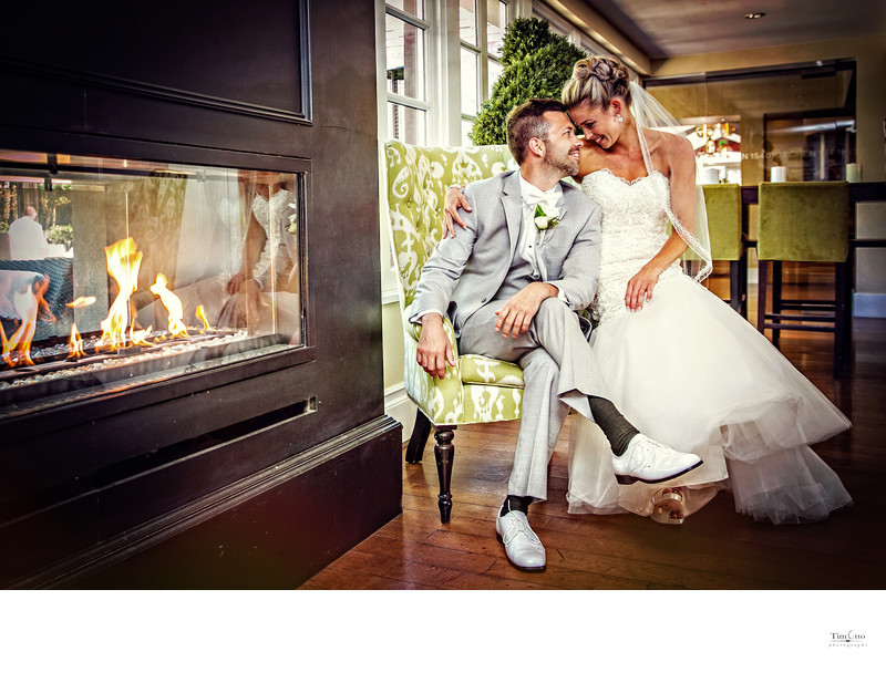 Bride and Groom enjoy fireplace at L'Auberge