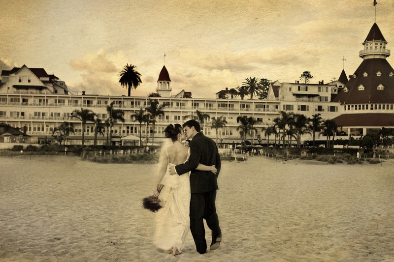 Kiss on the beach at Hotel Del Coronado wedding