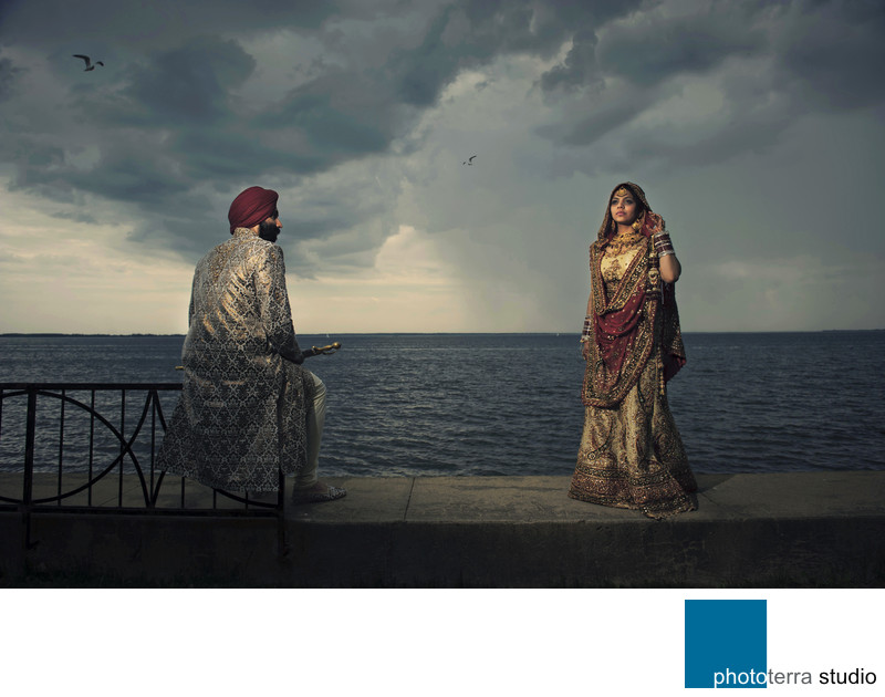 Sikh couple with Dramatic Sky by the water