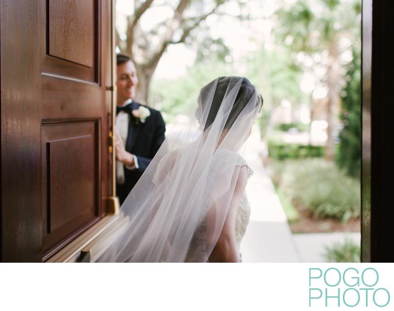Bride exiting church into Orlando courtyard