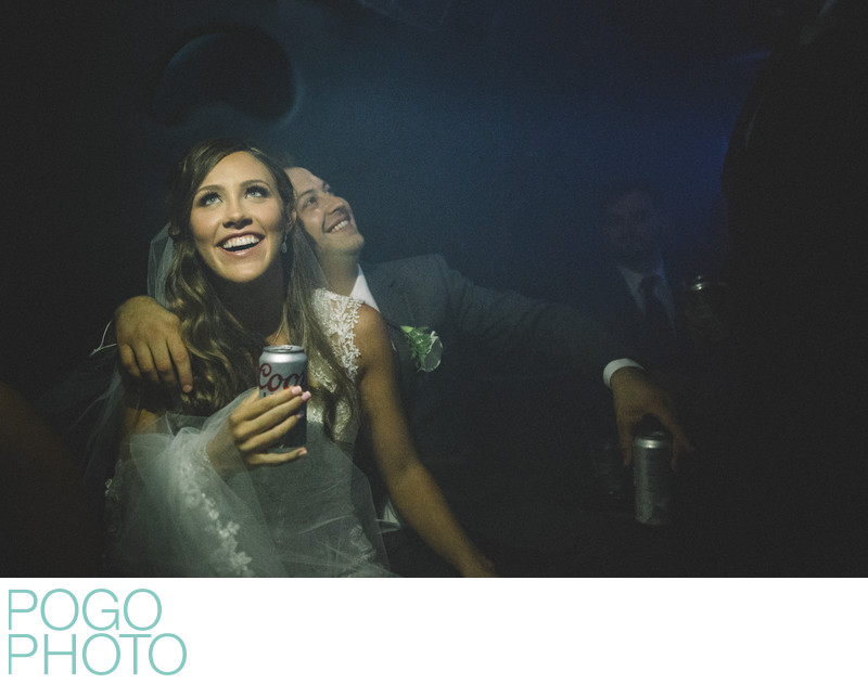 Excited Couple in Party Bus Lit by iPhone Flashlight