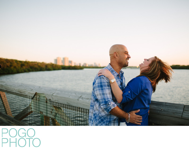 Engagement Photo on Boardwalk over Water at Sunset