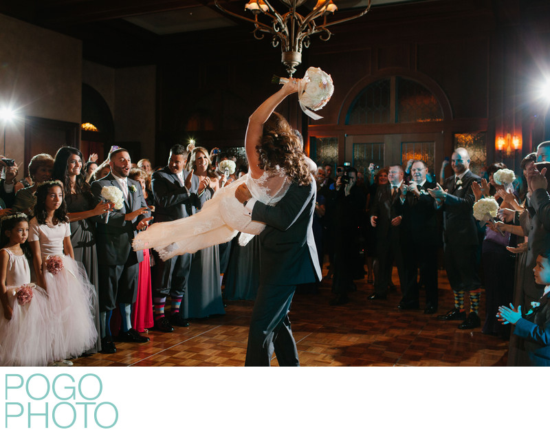 Groom Swinging Bride onto Dance Floor at Ritz Carlton