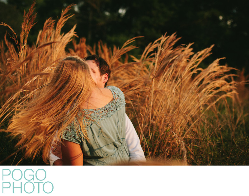 Rural FL Engagement Photography in Tall Grass at Sunset
