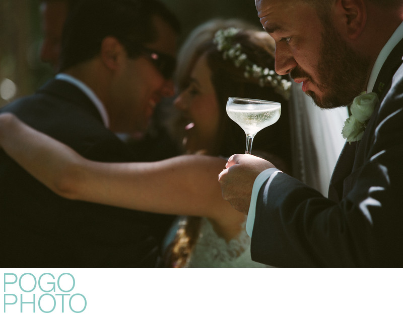 Champagne in Beam of Light at Morning Wedding Party