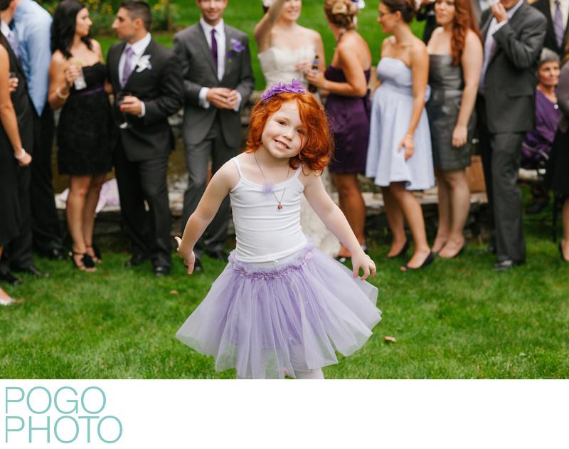 Vermont Flower Girl in Purple Tutu Goofs Off at Wedding