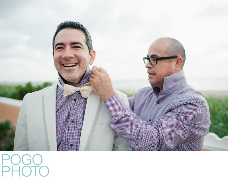 Two Grooms Help Each Other Prepare Before Gay Elopement