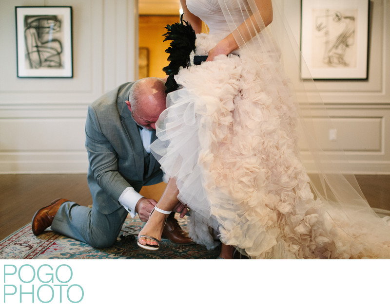 Dad Assists Bride with Shoe at Norton Museum of Art