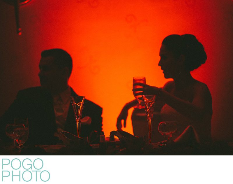 Orange Uplighting and Champagne at Fall Themed Wedding