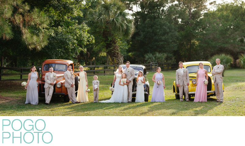 Wedding Party Panoramic Portrait with Antique Trucks