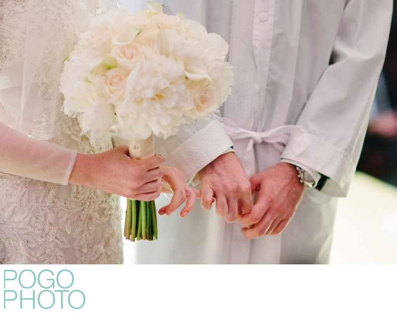 Intimate Wedding Ceremony Photo of Pinky Linking Bride