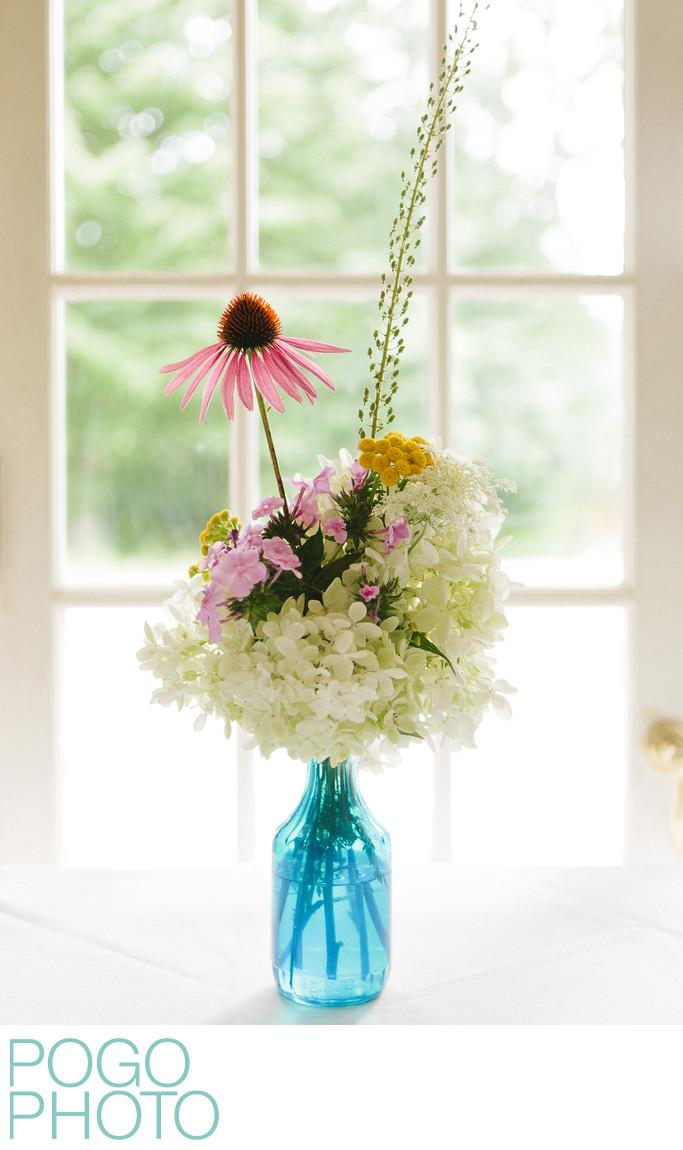 The Pogo Wedding: wildflowers in sheer blue vases