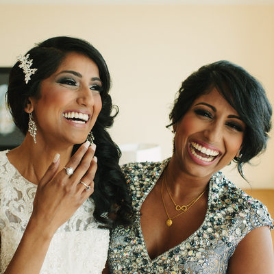 Excited sisters laugh on wedding day in West Palm Beach