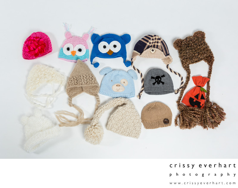 An assortment of newborn hats on hand at the studio