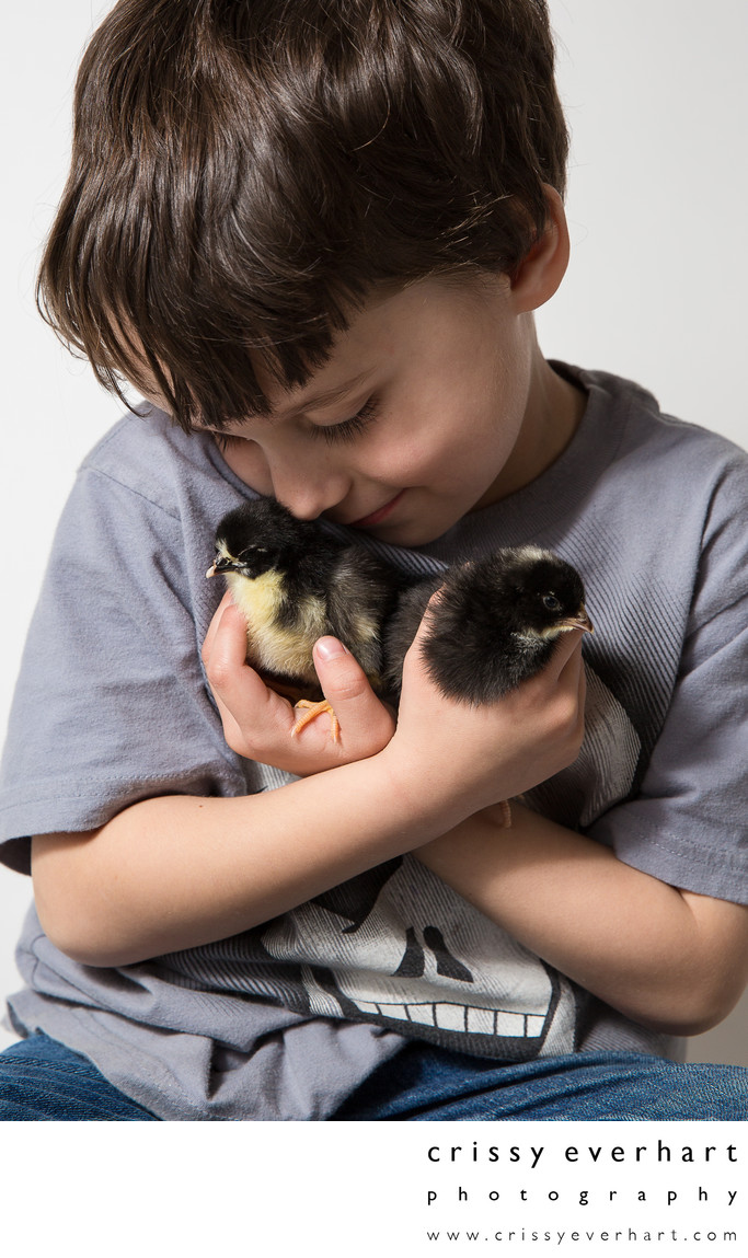 Five year old with two day old baby chicks