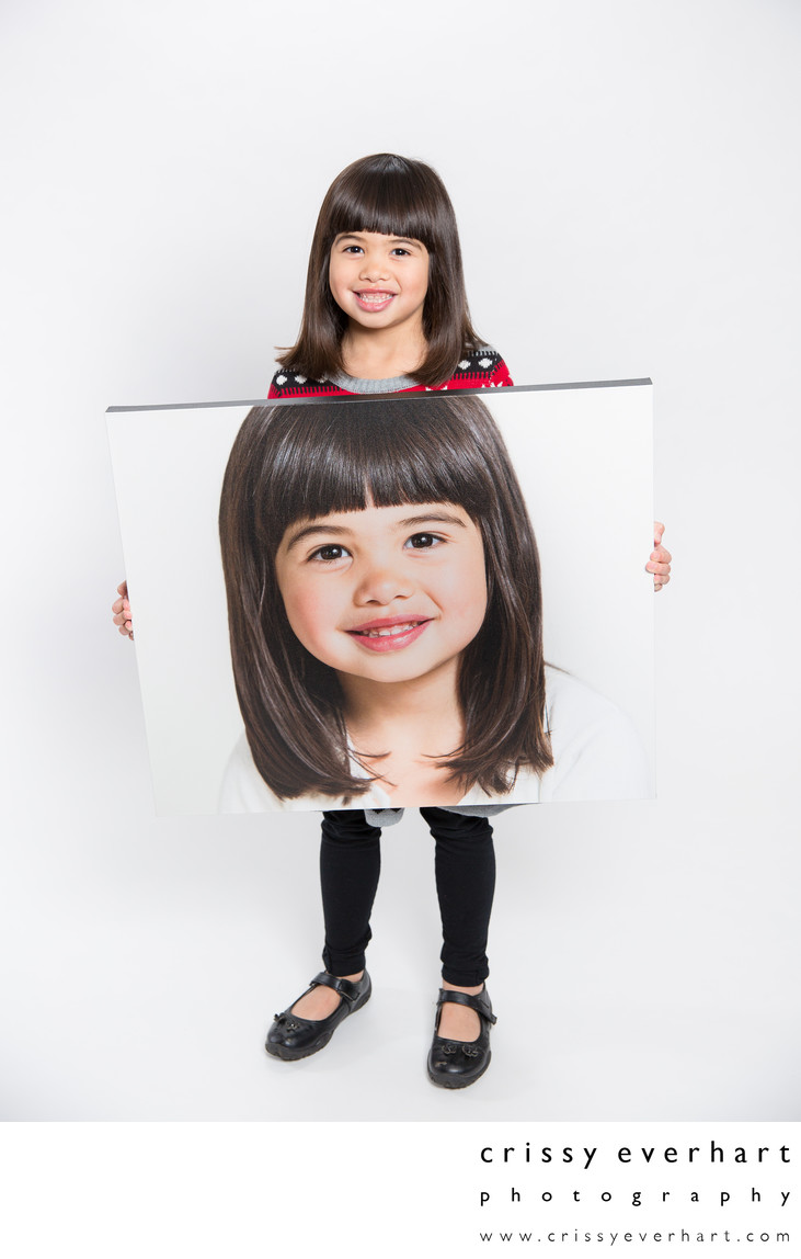 Six Year Old Holds Large Canvas Portrait of Herself