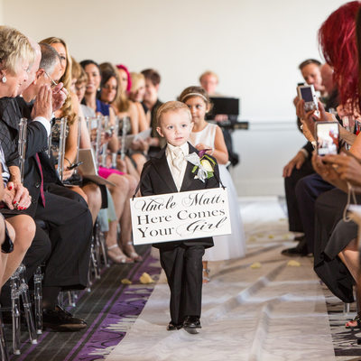 Down Town Club Ceremony - Ring Bearer Carrying Sign