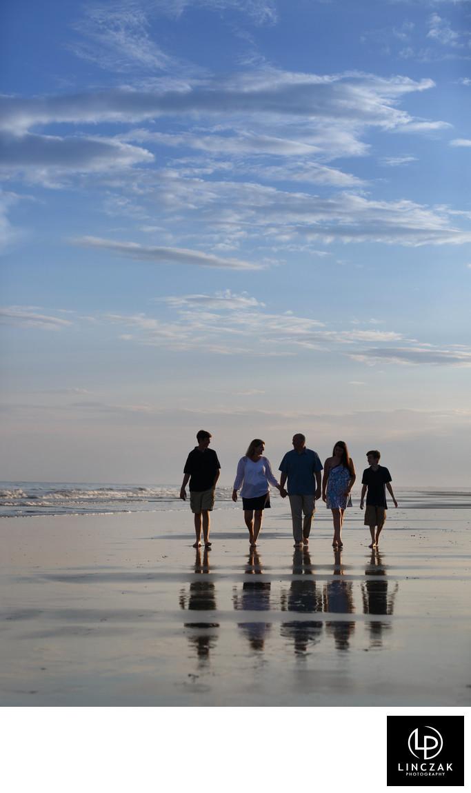 family stroll on beach photo