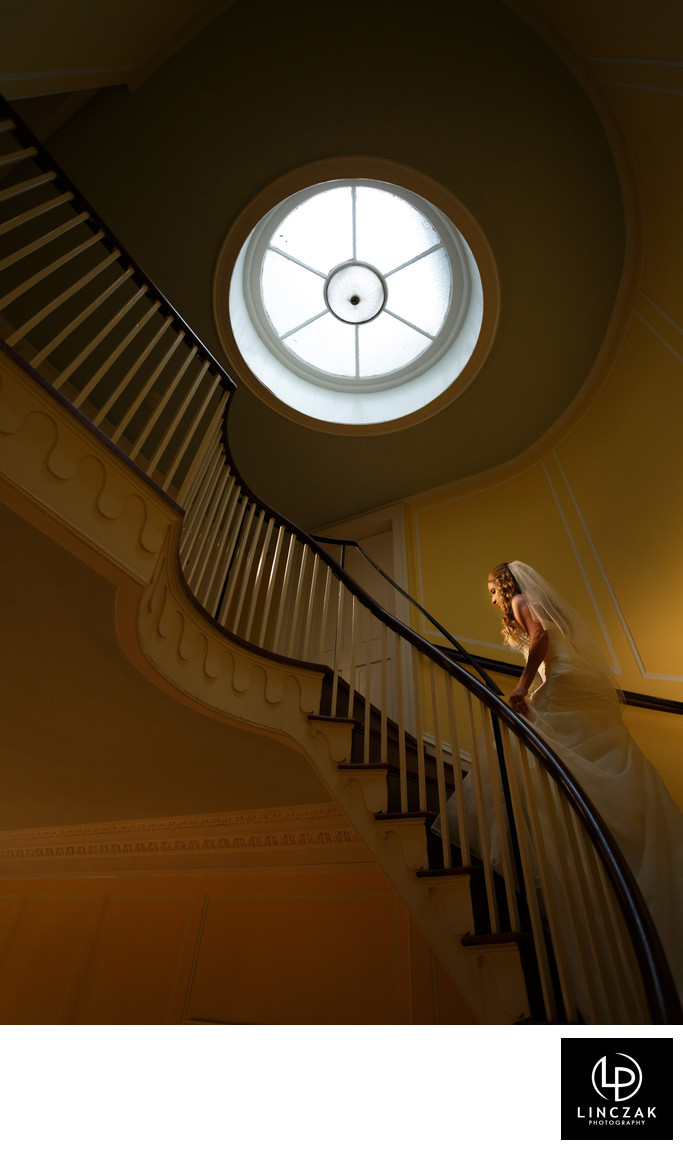 bride on staircase wedding photos