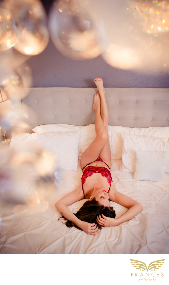 Sexy confident woman bedroom boudoir photography