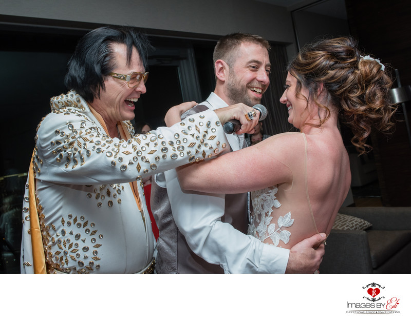 Elvis impersonator with bride and groom at Palms place penthouse suite