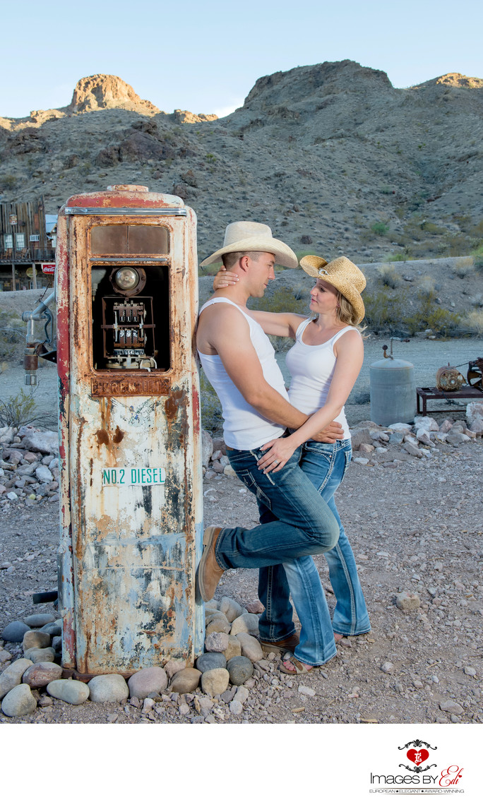 Fun wedding couple leaning on an old gas pump