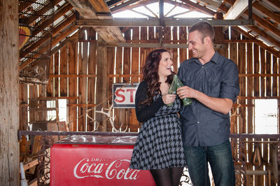 Nelson ghost Town couple is holding a coca cola bottle