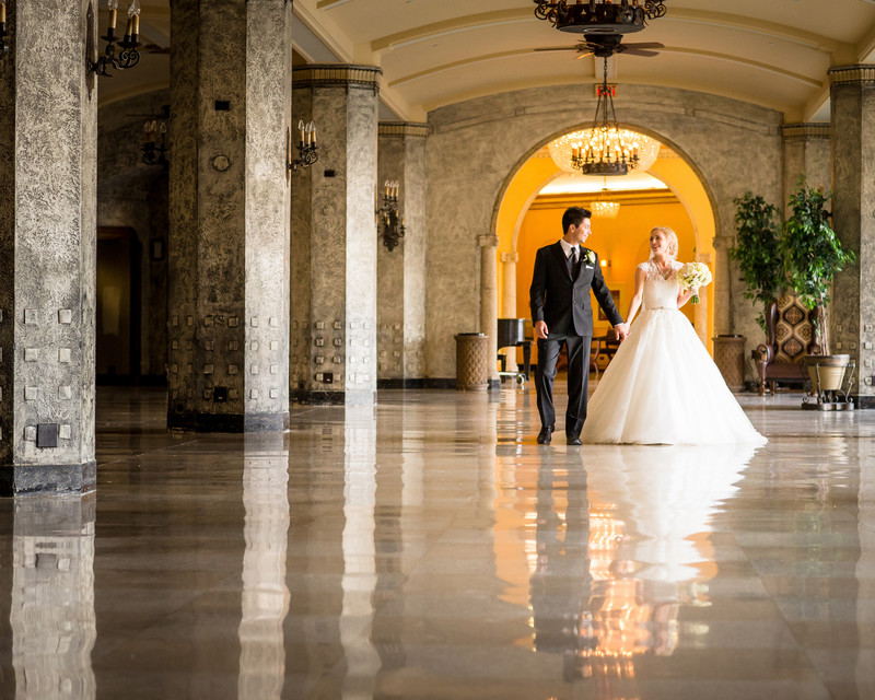 Bride + Groom Walking Together Banff Springs Hotel