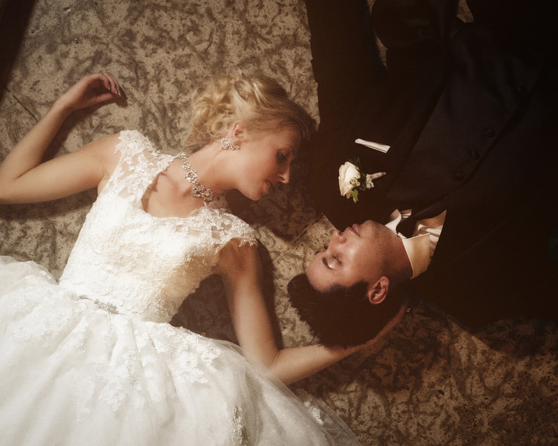 Bride + Groom Lying Down Together Banff Springs Hotel