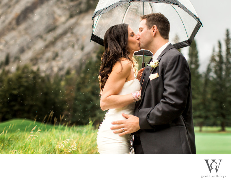 Bride and Groom Having Fun As It Rained in Banff