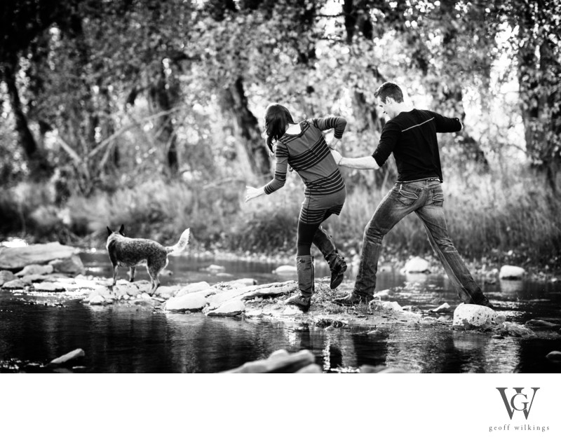 Engagement Photographs River Crossing Fun Laughter
