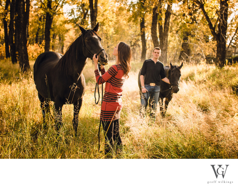 Cowboy Looking at Cowgirl During Engagement Shoot