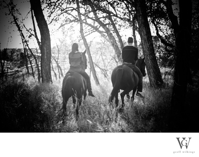 Cowboy and Cowgirl Riding Horses Engagement Shoot