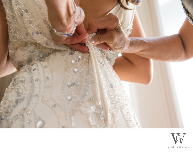 Close Up Photo Of Mom Helping Bride Get Ready
