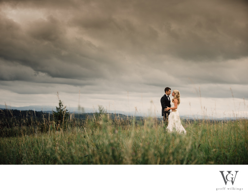Stormy Clouds As The Bride And Groom Have Fun Together