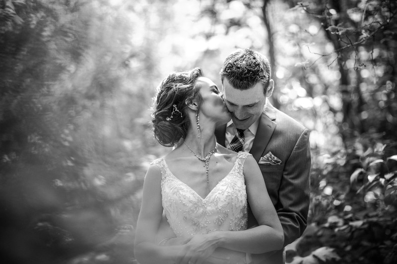 Bride Kissing Groom Calgary Wedding Photographers