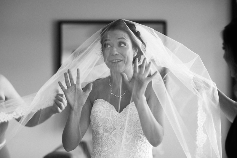 Bride Having Fun with Veil As It Goes Over Her Head