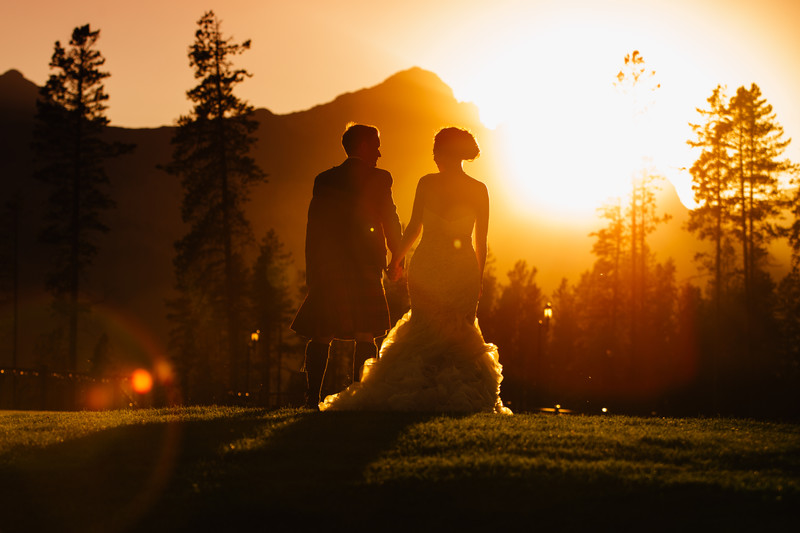 Sunset Photo of Bride + Groom Walking Into The Sunset