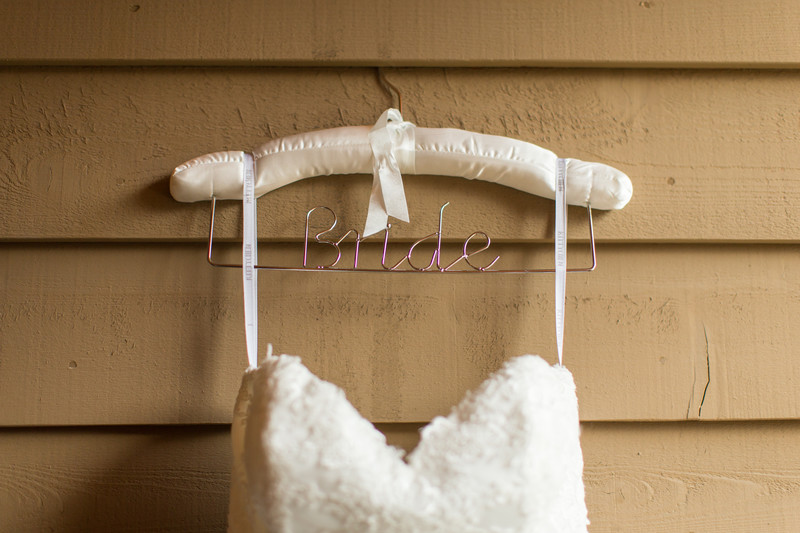Dress Hanging with Bride On The Coat Hanger