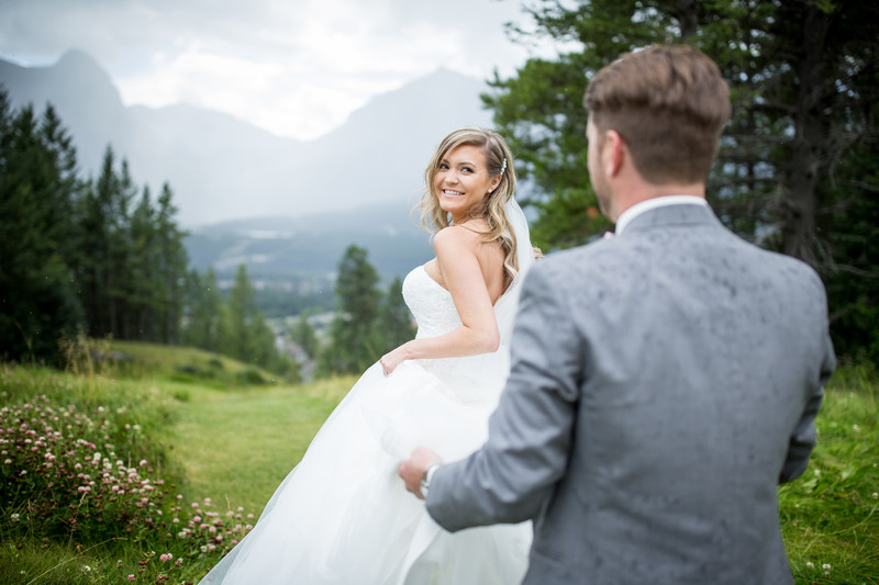 Bride Walking In Front Of Her Husband Silvertip Resort