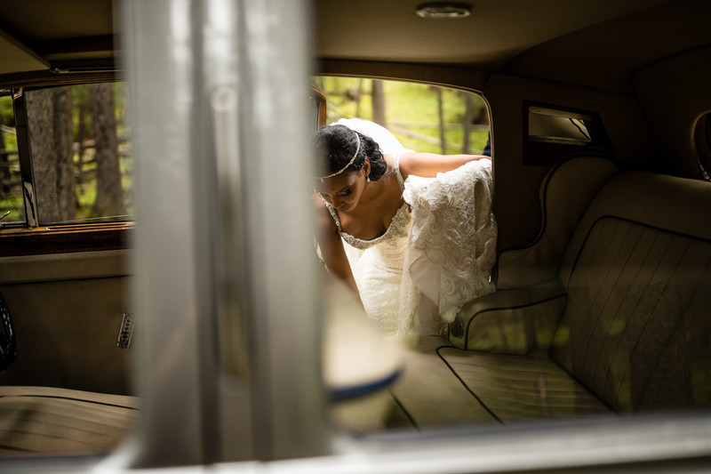 Bride Getting Into Highland VIP Limousine Banff Park