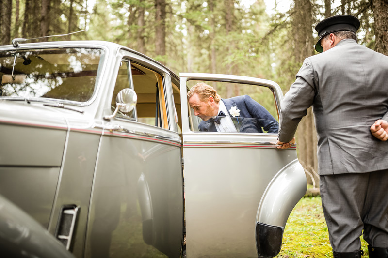 Groom Walking Into Limousine Banff National Park