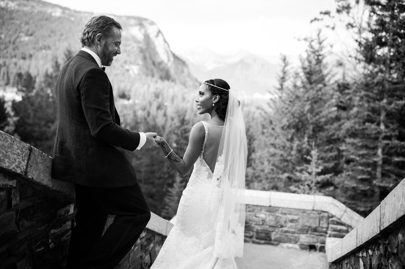 Bride + Groom Walking Down Banff Springs Hotel Stairs