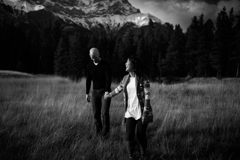 Walking In Banff National Park Laughing Engagement Photos